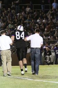 Dr. Kern escorts a player off of the field
